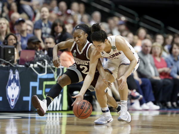 Mississippi State guard Morgan William (2) and Connecticut guard Kia Nurse (11) dive attempting to win control of a loose ball during an NCAA college basketball game in the semifinals of the women's Final Four, Friday March 31, 2017, in Dallas.