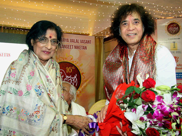 The Indian vocalist Kishori Amonkar and tabla player Zakir Hussain posing at an awards ceremony in Mumbai, India in February 2016. Amonkar died on April 3, 2017 at age 84.
