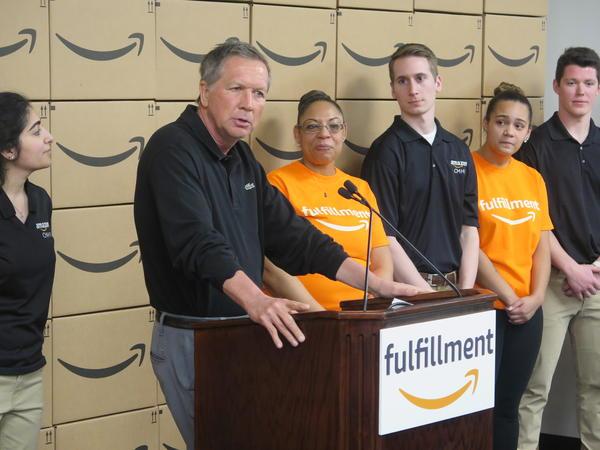 Gov. John Kasich speaks before a tour of Amazon's fulfillment center in Pataskala.