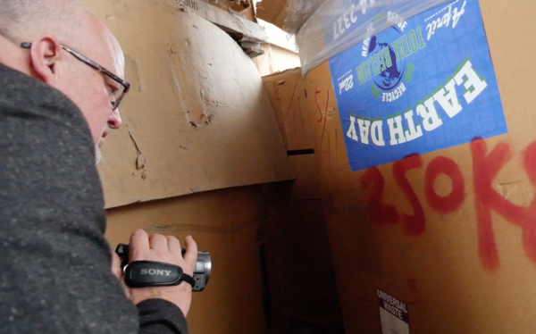 <p>Jim Puckett discovers boxes bearing Total Reclaim's logos in an e-waste dismantling facility in rural Hong Kong.</p>