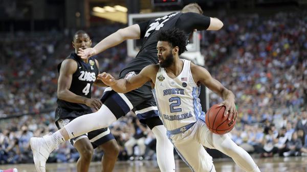 North Carolina's Joel Berry II drives around Gonzaga's Przemek Karnowski during the first half of Monday's NCAA college basketball tournament title game in Glendale, Ariz.