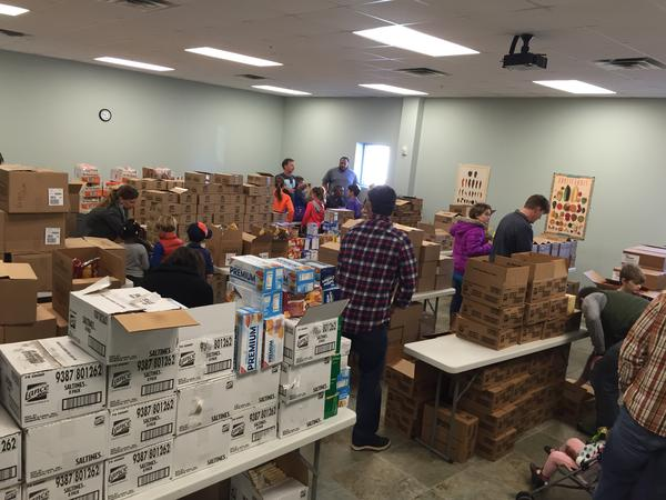 Kids and family members volunteer along with members of the Baton Rouge Emergency Aid Coalition to help supply food bags for children who would have otherwise gone hungry during the aftermath of the floods.