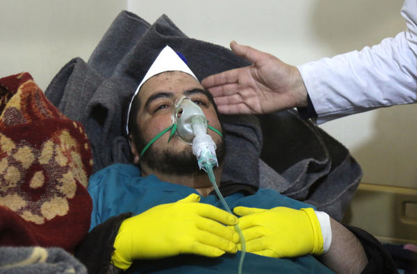 A Syrian man receives treatment following a suspected toxic chemical attack Tuesday in Khan Shaykhun, a rebel-held town in Syria's northwestern Idlib province. At least 72 people were killed, including a number of children.