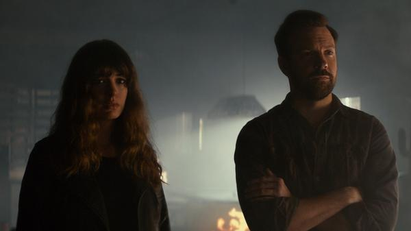 Where There's Smoke, There's Kaiju: Gloria (Anne Hathaway) and Oscar (Jason Sudeikis) look pensive in <em>Colossal</em>.