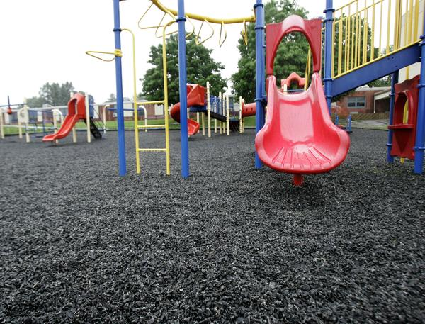 Ground-up recycled tire crumbs cover this playground.