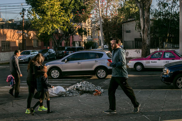Dr. Tonatiuh Barrientos Gutierrez, an epidemiologist in Mexico City, jogs near his home in the southern part of the capital. He says it's hard to run on the city's streets.