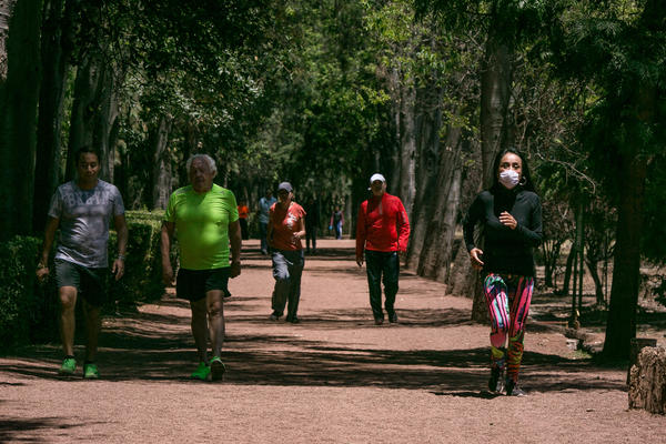 Runners in the wooded park of Viveros in Coyoacan, Mexico City. Mexico City has few runner-friendly spaces. The altitude discourages exertion and the air quality is often so bad some runners wear face masks. Yet health officials urge people to exercise more.