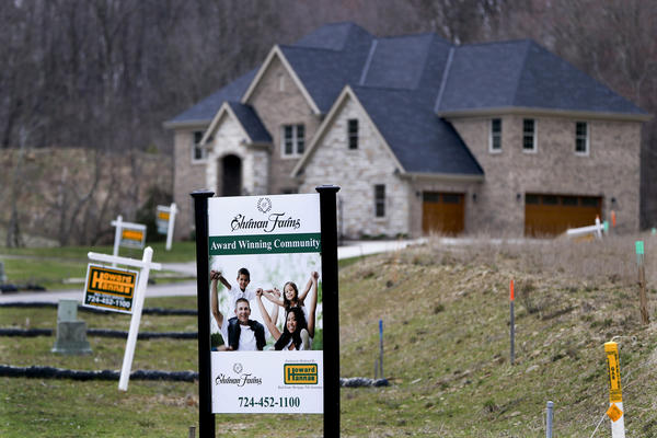 In this Monday, Feb. 27, 2017, photo, real estate signs mark the lots near one of the new homes for sale in a development for new homes in Cranberry Township, Butler County, Pa. (Keith Srakocic/AP)