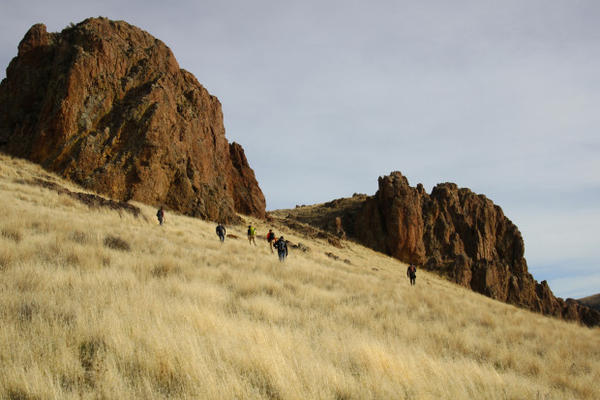 <p>Giant red rock formations protrude from grassy, rolling hills. Although the Owyhee is known for its canyons, the majority of the land mass in the area is high desert sagebrush country. </p>