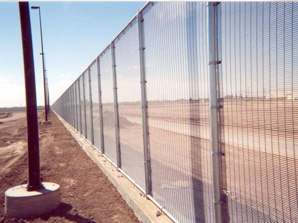 "The WireWall fence now in place in California on the border with Mexico. Riverdale Mills says the fence is produced using the same manufacturing process as its ""marquee marine wire mesh"" designed for lobster traps used in New England."