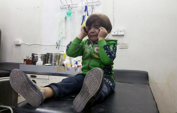 A child receives treatment at a hospital after Tuesday's attack on the town of Khan Shaykhun in Syria's Idlib province.