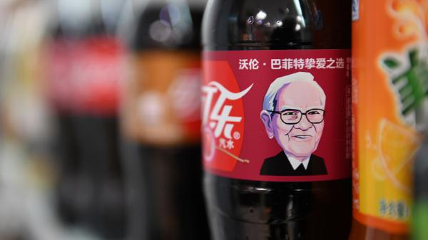 A Cherry Coke bottle featuring an image of investor Warren Buffett is seen on a shelf at a convenience store in Beijing on Wednesday. His likeness is gracing Cherry Coke cans in China, where he enjoys a legendary reputation.
