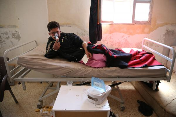 A survivor of the suspected chemical attack receives treatment at a hospital in Khan Shaykhun on Wednesday.