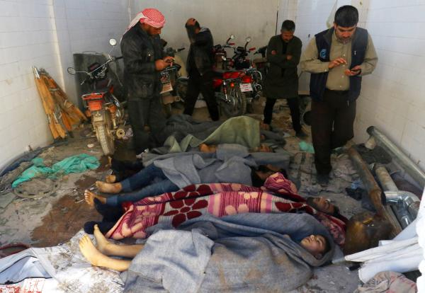 Bodies are wrapped in blankets after a suspected chemical attack in the town of Khan Shaykhun on Tuesday.