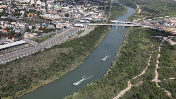 U.S. Border Patrol boats move along the Rio Grande near an international crossing between the United States and Mexico on March 16. Customs and Border Protection have announced that apprehensions along the southwest border dropped in both February and March, when they usually rise.