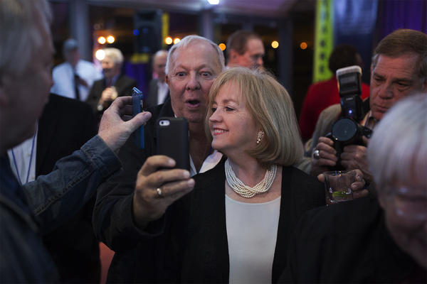 Lyda Krewson poses with attendees at her election night watch party.