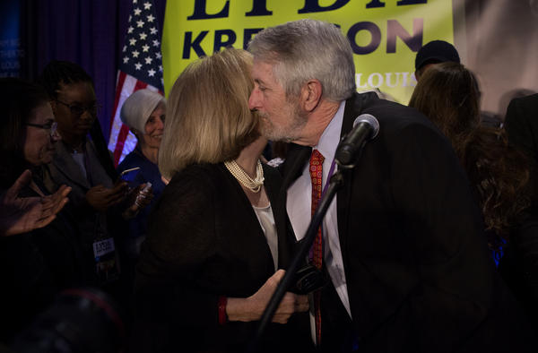 Lyda Krewson hugs her husband, Mike Owens, after delivering her acceptance speech.