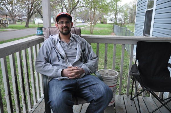 Sam Werkmeister, 30, sits on his porch in Granite City. Werkmeister is recovering from an addiction to opioids, which began with pain pills taken without a prescription.