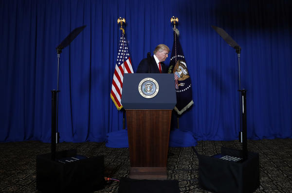 President Trump leaves the podium at Mar-a-Lago in Palm Beach, Fla., Thursday night after the U.S. fired a barrage of cruise missiles into Syria in retaliation for this week's chemical attack against civilians.