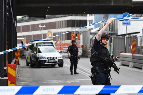 Police secure the scene where a truck crashed into the Ahlens department store in central Stockholm on Friday.