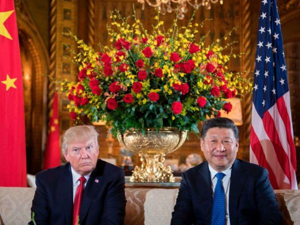 President Trump sits with Chinese President Xi Jinping during a Thursday meeting at the Mar-a-Lago resort in Florida. The pair's first in-person talks wrap up Friday.