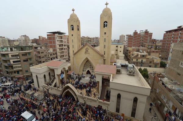 Relatives and onlookers gather outside a church after a bomb attack in the Nile Delta city of Tanta, Egypt on Sunday.