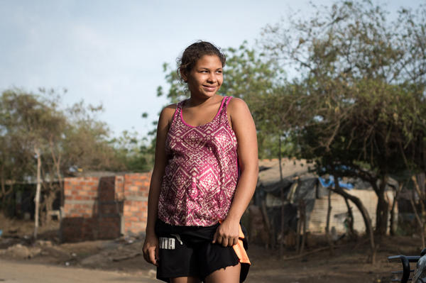 """María Marcela Calderón outside her home in León, a city in western Nicaragua. At 19, she is the mother of a 3-year-old and pregnant with her second child. """"My child is my happiness,"""" she says."""