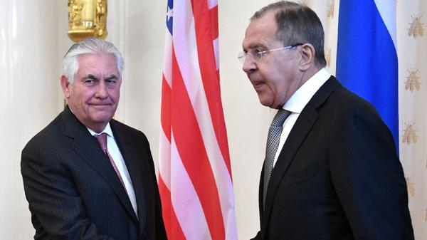 Secretary of State Rex Tillerson shakes hands with Russian Foreign Minister Sergey Lavrov at the start of their meeting in Moscow. Russia has accused the U.S. of breaking international law with its missile strike on Syria last week.