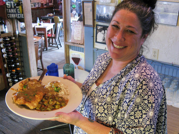Hilltop waitress Kayla Young serves up one of the Zagat-rated restaurant's dishes, chicken-fried steak.