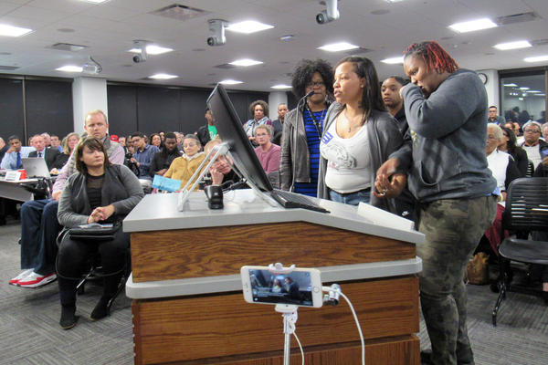 Mothers Shawndryka Moore, Jacquetta Sims, and IKeshia Quinn address the Grand Rapids City Commission on April 12, 2017.