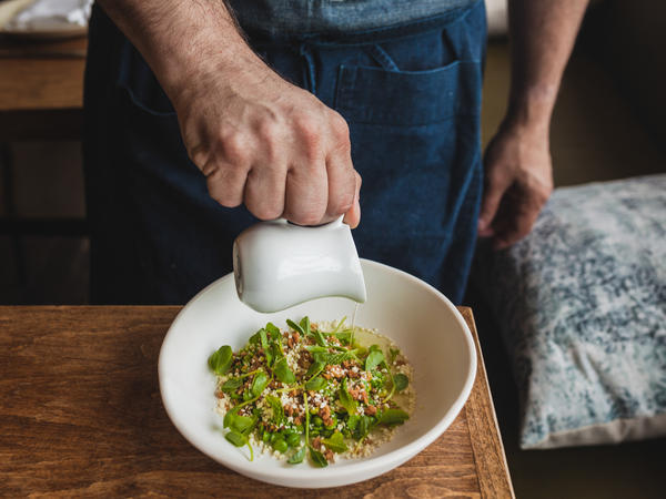 "Chef Jeremy Fox's inventive dish: double-chucked spring peas sprinkled with white chocolate and roasted macadamia nuts. It's served with a bit of pea broth poured on the side, ""to retain the crunch."" Each pea is shucked, blanched and squeezed to get the halves out. It's a labor preparation that he serves only on special occasions, like Valentine's day."