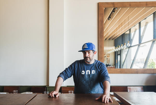 "Fox at the Santa Monica restaurant, Rustic Canyon, where he's now head chef. Born in Cleveland, he proudly wears his 'Ohio Against the World' hat. And beneath his apron, the proud father of 16 month-old-daughter Birdie wears his ""pop"" sweatshirt."