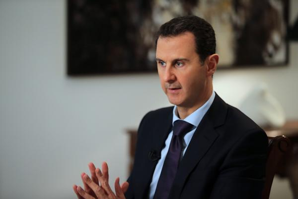 Syrian President Bashar Assad speaks in an earlier interview with AFP, in February 2016 in Damascus.