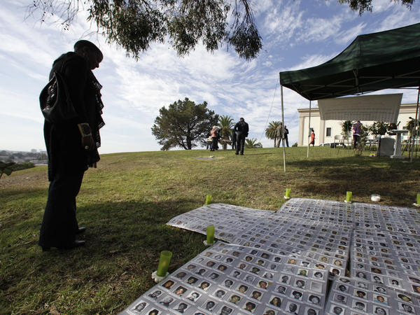 A 2010 memorial service for the Jonestown massacre in Oakland, Calif., featured photographs of the victims.