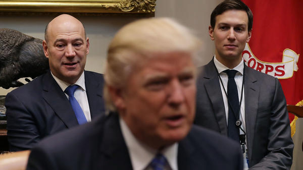 Trump's economic adviser Gary Cohn (left) and adviser Jared Kushner listen to President Trump at a meeting with business leaders Jan. 23.