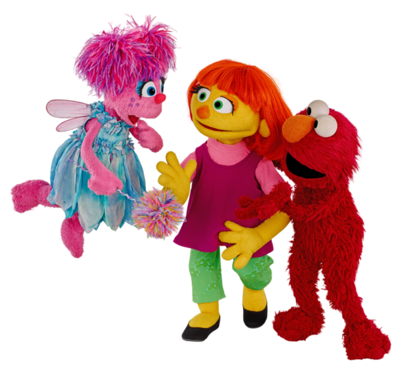 """The puppet in the middle of the photo, """"Julia"""", is a new 'Sesame Street' character designed to teach children about autism."""