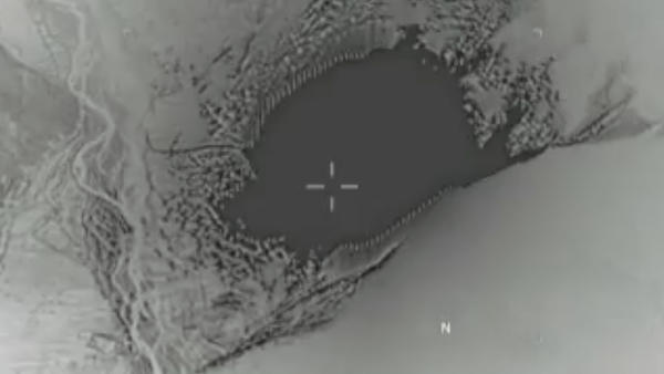 This image made from a Thursday, April 13, 2017 video released by the U.S. Department of Defense shows a GBU-43/B Massive Ordnance Air Blast bomb strike on an Islamic State militant cave and tunnel systems.