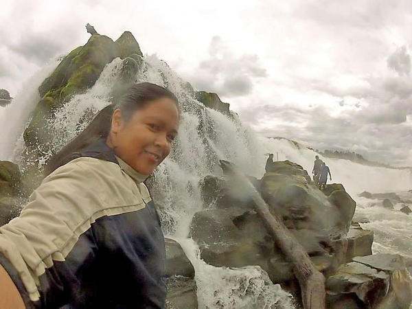 Emily Washines snaps a selfie while fishing for lamprey at the slippery and treacherous Willamette Falls.