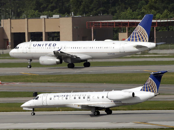 Two United Airlines planes taking off at George Bush Intercontinental Airport in Houston. After a man was dragged off a United flight, the company changed its policy on overbooked flights.