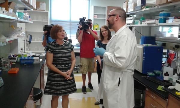Congresswoman Kathy Castor talks with Jeremy Baker, a third-year neurology grad student