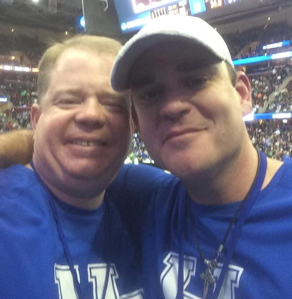 Christopher Deaton (left) with his late brother, Jeremy Deaton (right), at a basketball game.