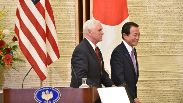Vice President Pence and Japanese Deputy Prime Minister and Minister of Finance Taro Aso leave the prime minister's official residence in Tokyo on Tuesday. Pence said the U.S. and Japan had launched talks that could eventually result in a bilateral trade deal between the two economies.
