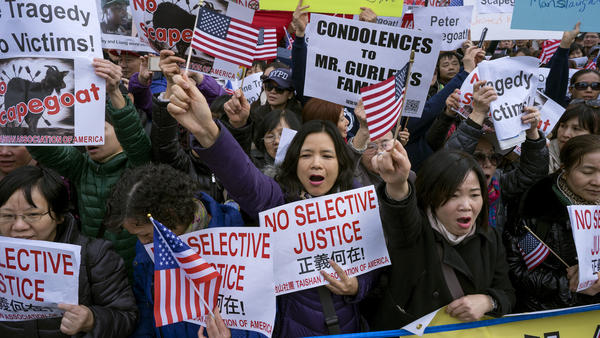 Protesters attend a rally in Brooklyn, N.Y., in 2016, in support of former NYPD Officer Peter Liang, who was convicted of manslaughter and official misconduct for the shooting death of Akai Gurley in a housing development stairwell.