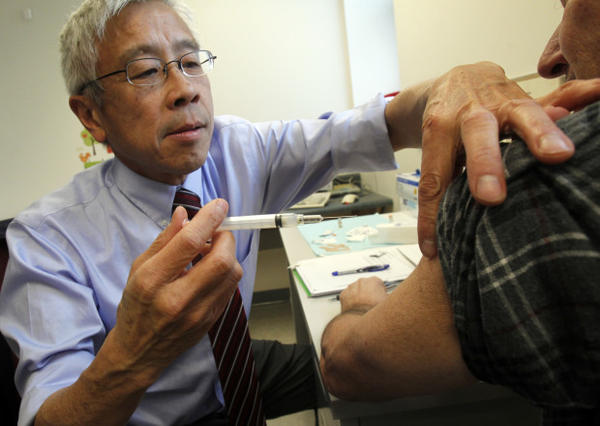 <p>Dr. Harry Chen gives a whooping cough vaccine on Wednesday, Dec. 19, 2012 in Barre, Vermont.</p>