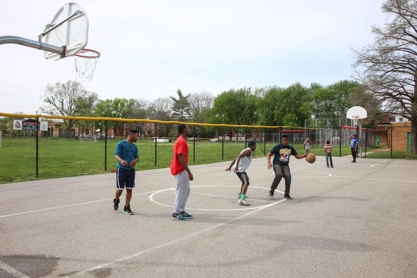 Basketball players take advantage of the Fox Park courts this week.