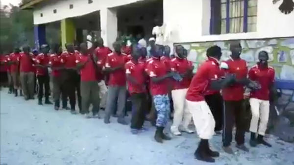 "According to the U.N., the militia members in this video ""repeatedly chant a call to impregnate or kill opponents."""