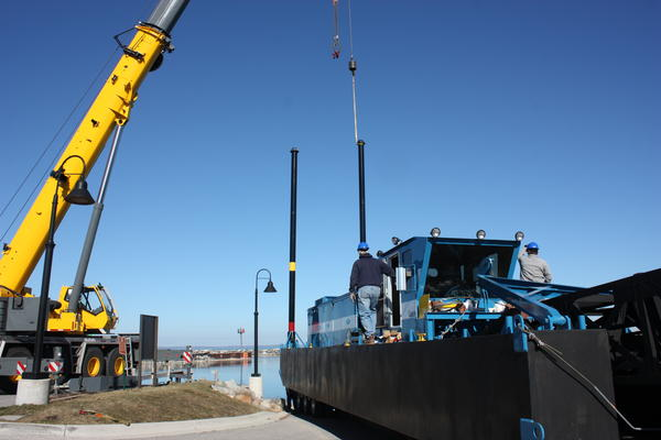 Crane prepares to unload dredging equipment