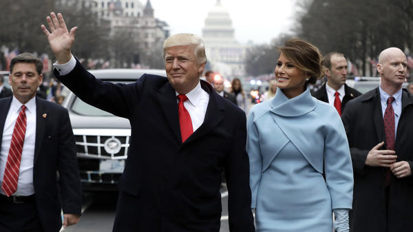 President Trump waves to supporters as he walks the parade route with first lady Melania Trump after being sworn in on Jan. 20.