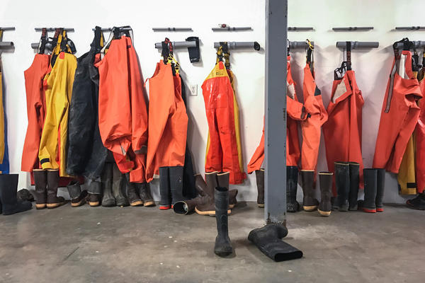 Workers' gear hangs inside Lobster Trap's facility in Steuben, Maine.