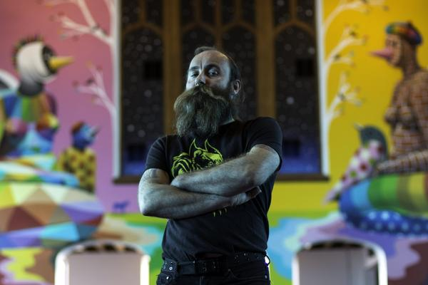 Co-founder Lee Molloy stands in the chapel of the International Church of Cannabis. The building is a former church found on Logan Street in Denver. (Corey Jones/CPR News)
